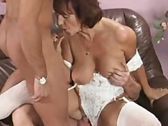 Appetizing granny is showing off her playful lingerie