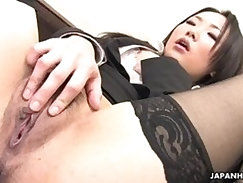 Attractive Japanese gal in stockings enjoys sex with two well endowed guys