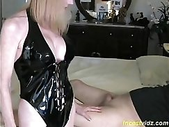 Brunette mom fucks herself with a that small red flute