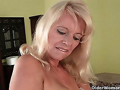Blonde granny wife gives BJ and gets cum all over her face