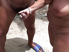 Beautiful tan young bitch shows her self on the beach