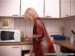 Blonde babe gets fucked in the kitchen
