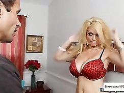 Busty mommy poses on the bed while her son comes home