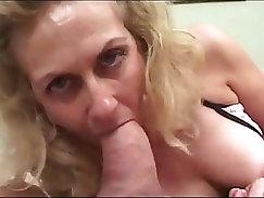 Granny smokes while sucking cock