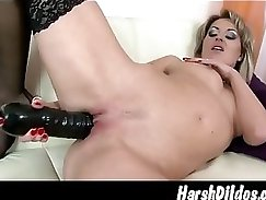 Brown haired pimp fucks her snatch with dildo